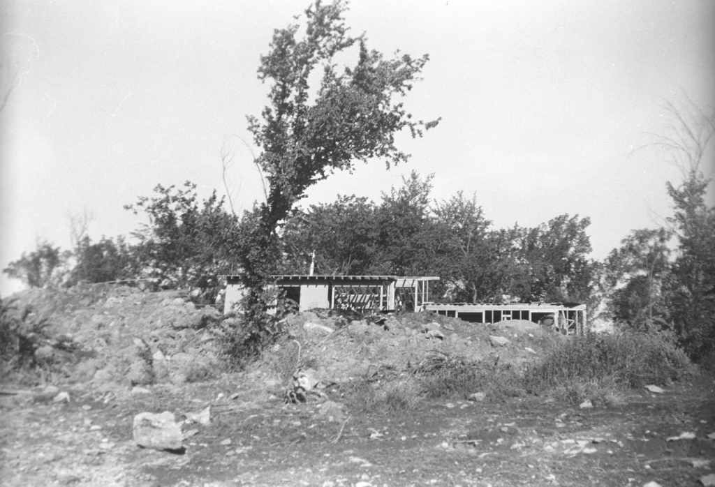 Road view of partially constructed house