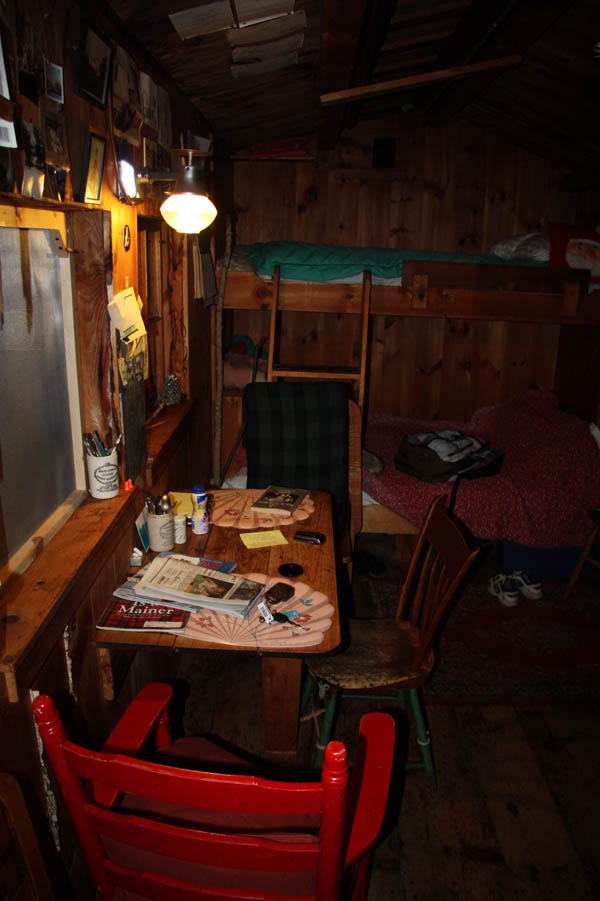 Interior at night, illuminated by kerosene lamp